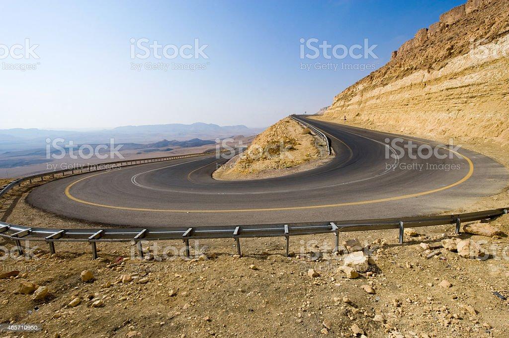 Hairpin bend in desert stock photo