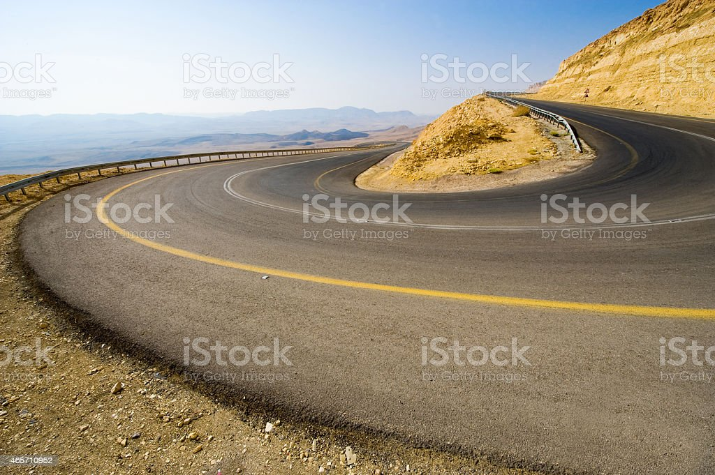 Hairpin bend in desert stock photo