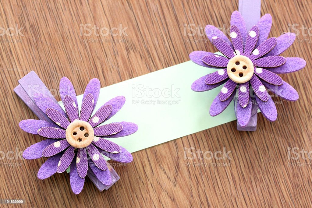 Hairpins of purple flower and note paper. royalty-free stock photo