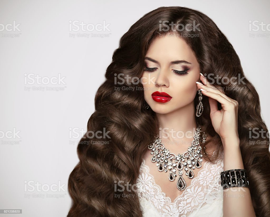 Hairstyle. Healthy hair. Makeup. Beautiful brunette girl stock photo