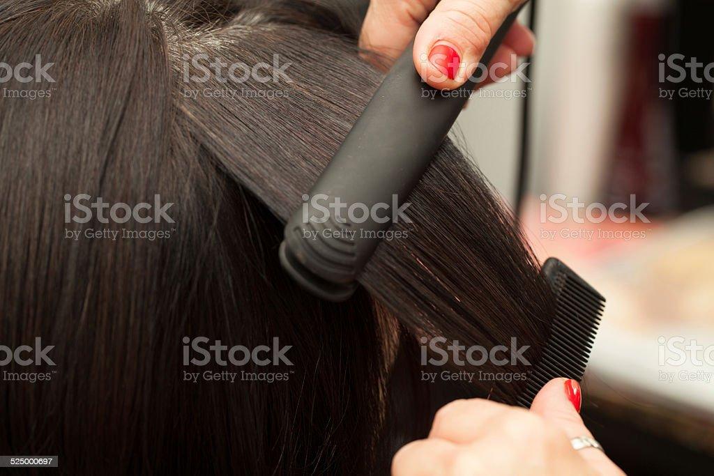 Hairstyling, Straightening stock photo