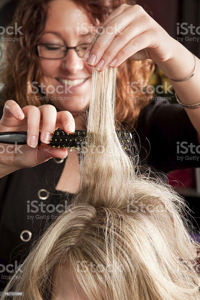 Hairstylist teasing hair stock photo