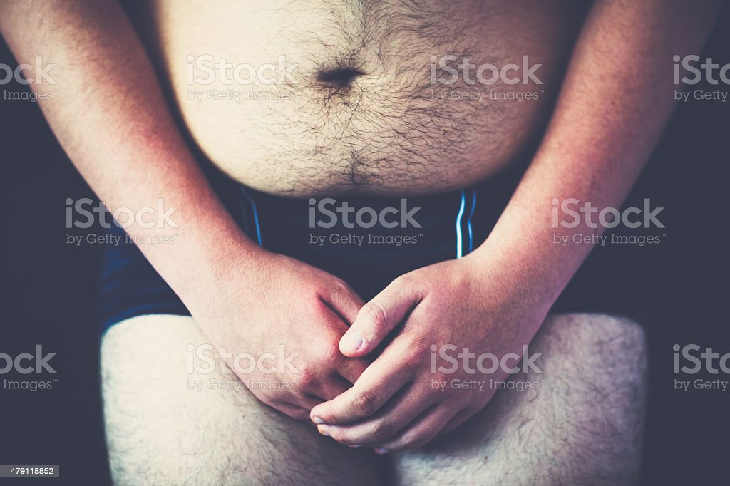Hairy male belly stock photo