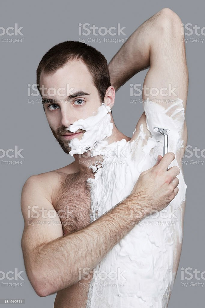 Hairy Man Body Shaving royalty-free stock photo