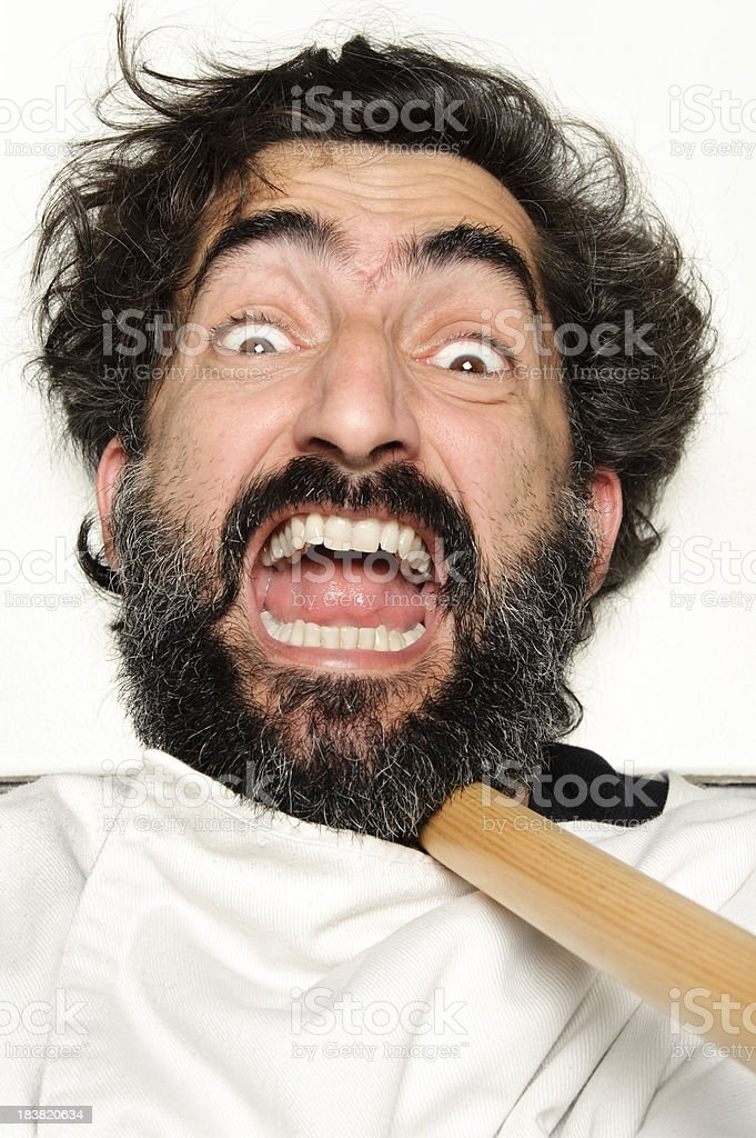 Hairy man on the floor being attacked with a stick royalty-free stock photo