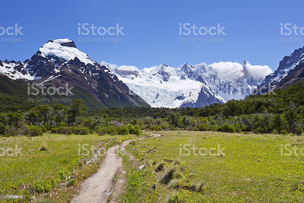 Haking path between tall mountains near Cerro Torre, Argentinian Patagonia royalty-free stock photo