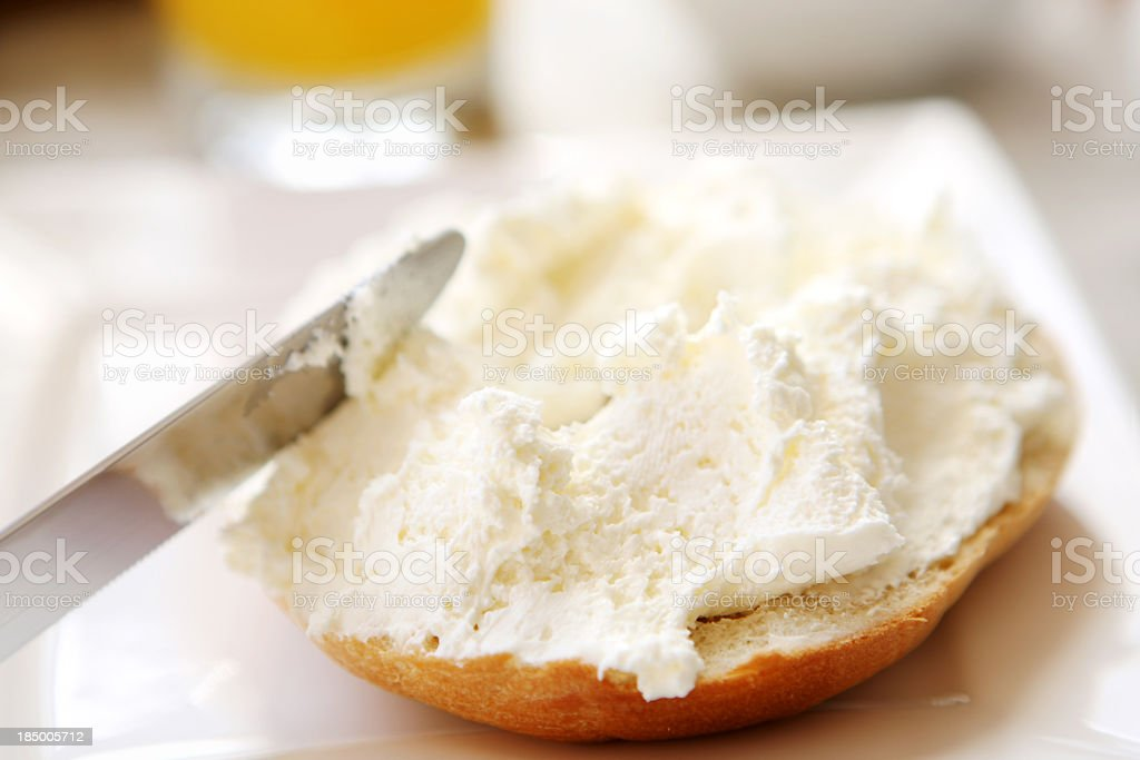 Half a bagel with cream cheese stock photo