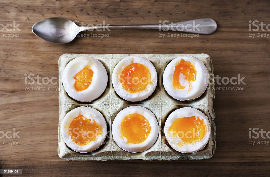 Half a dozen soft boiled eggs. stock photo