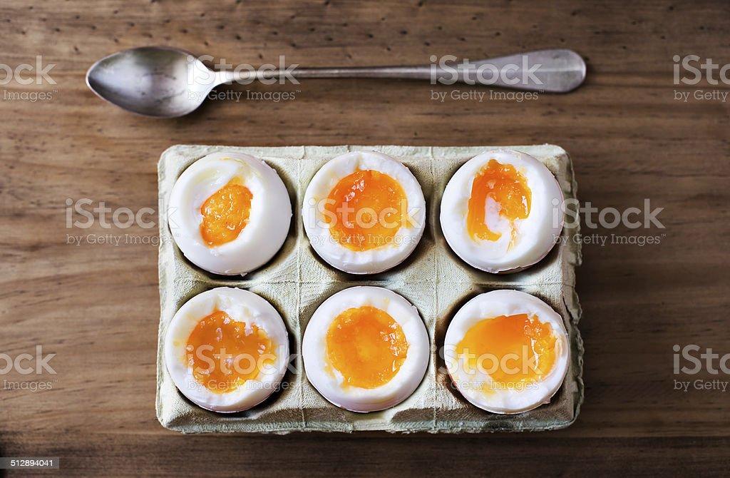 Half a dozen soft boiled eggs. stock photo