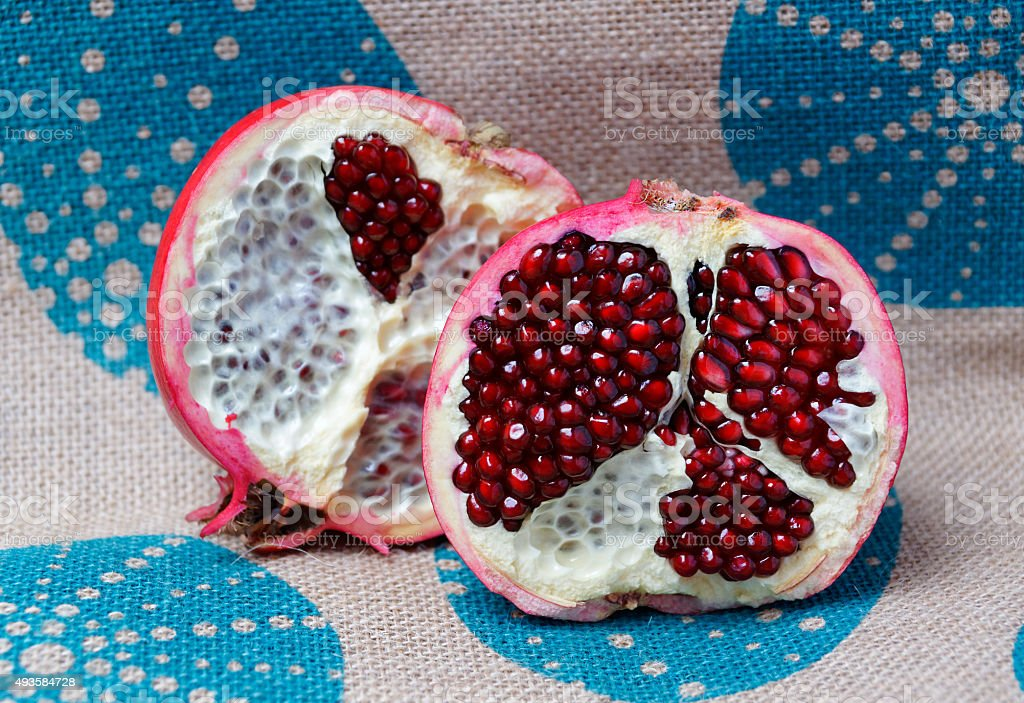 Half a large red pomegranate stock photo