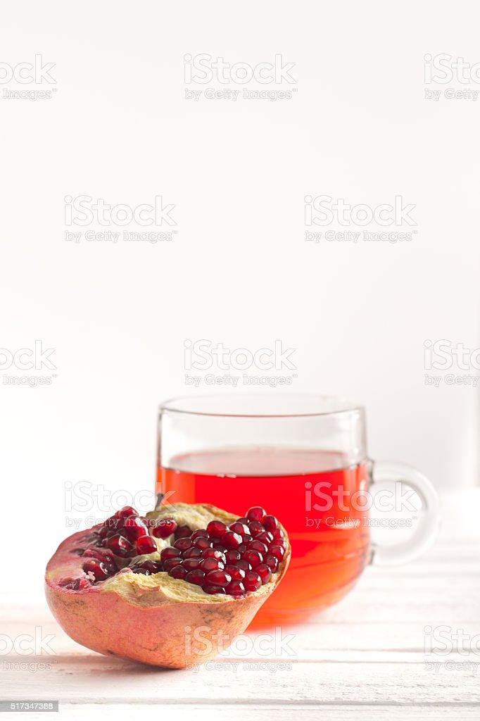 Half a ripe pomegranate and juice stock photo