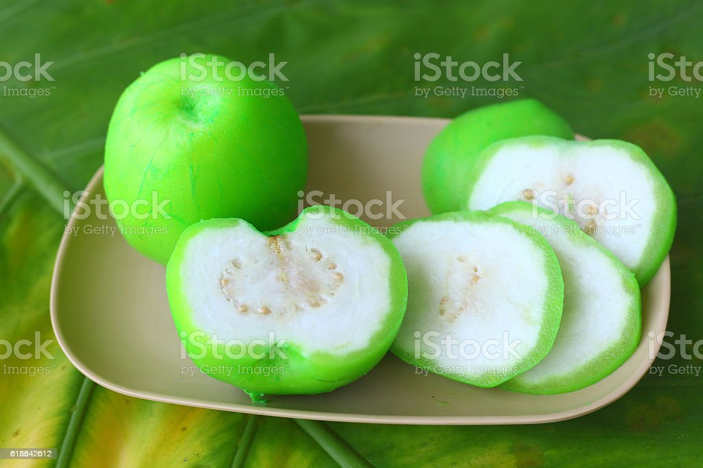 half and cut slices green guava close up photo stock photo