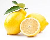 Half and whole lemons against white background