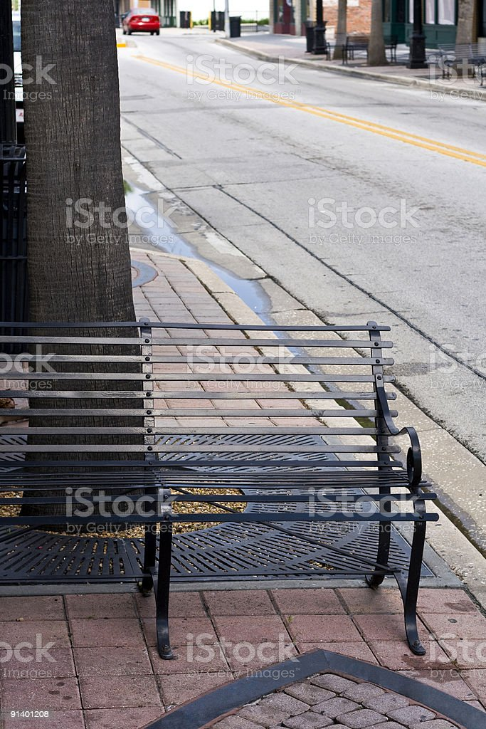 Half Bench with View Down Street stock photo