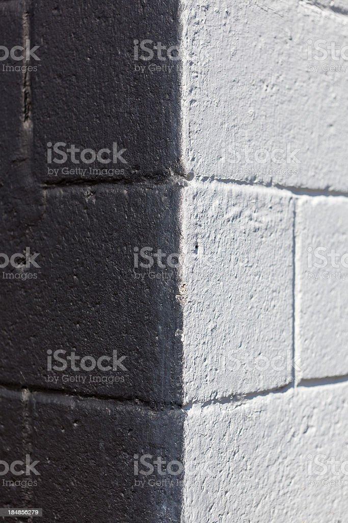 Half black- Half white cinder block wall royalty-free stock photo