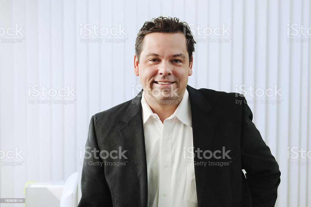 Half Body Portrait of Working Businessman in White Office royalty-free stock photo