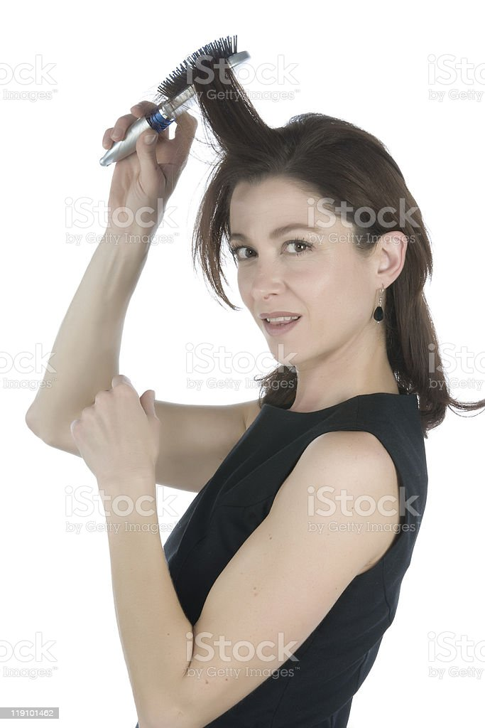Half body shot of a woman brushing her hair up stock photo