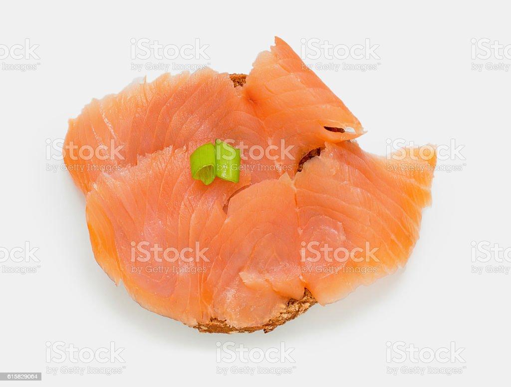 Half bun with smoked salmon on white stock photo