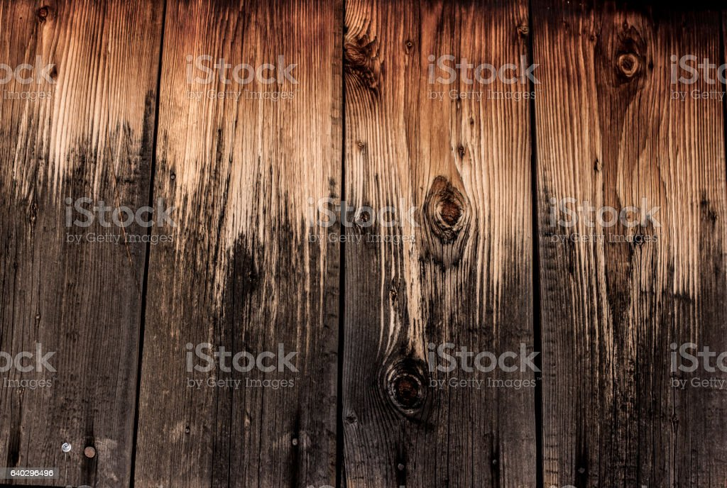 half burnt wooden wall stock photo
