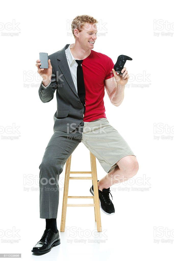 Half businessman / casual man with phone stock photo