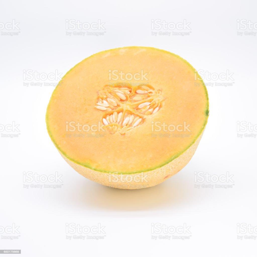 Half cantaloupe isolated on a white background stock photo