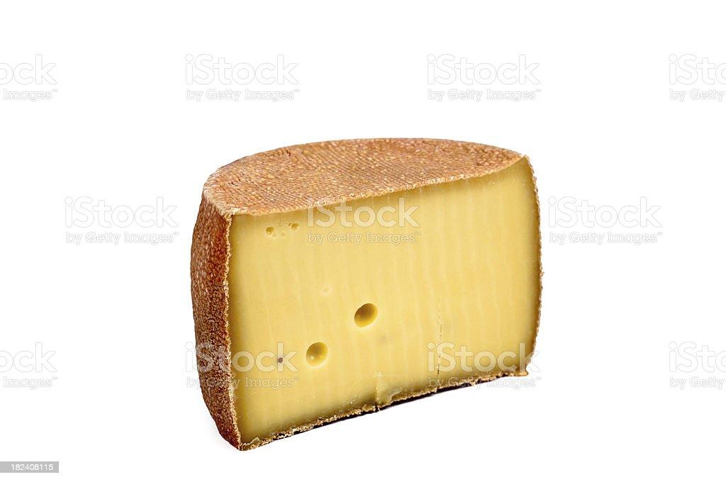 half cheese wheel with hole stock photo