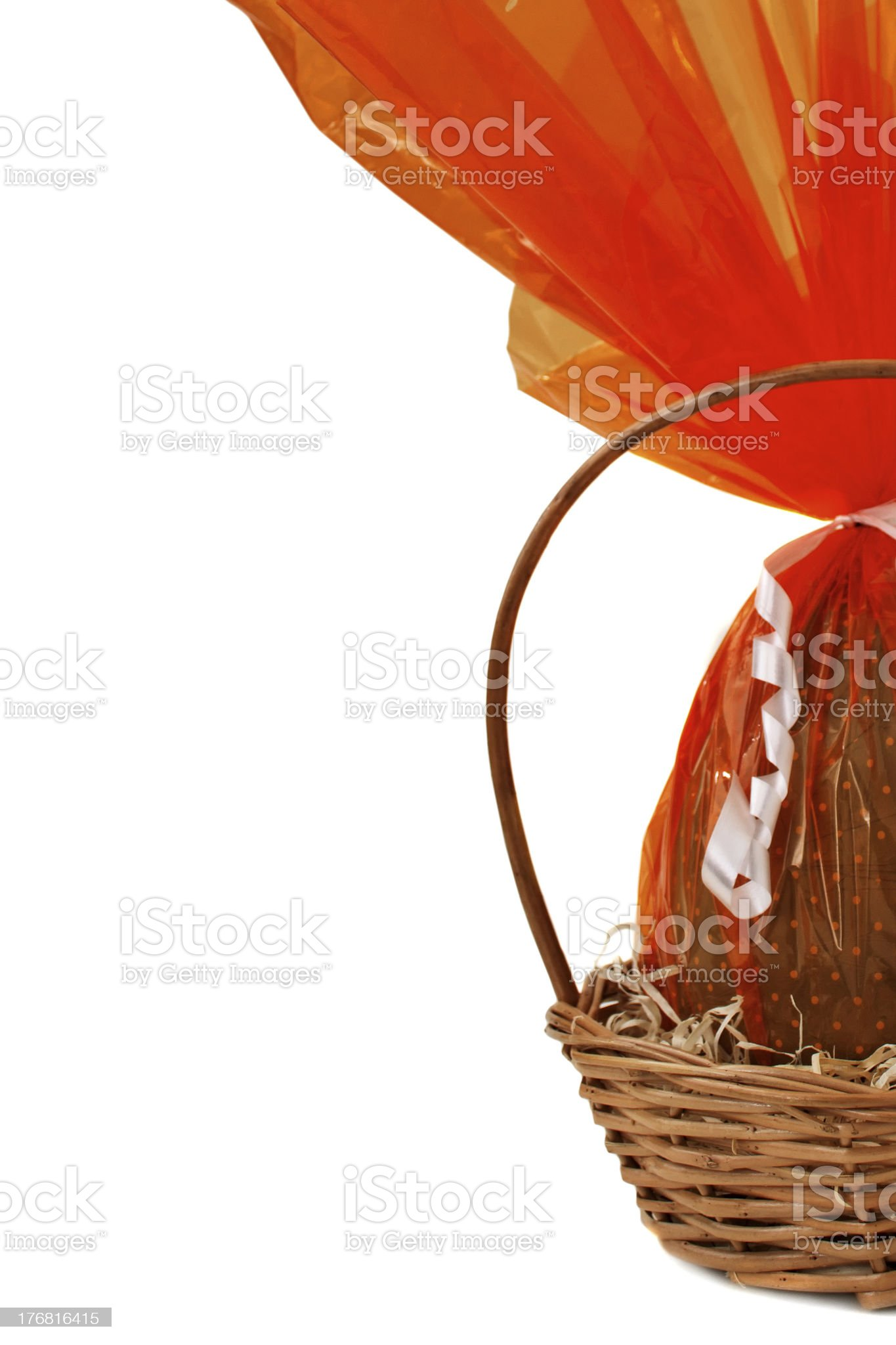 Half chocolate Easter Eggs into a basket royalty-free stock photo