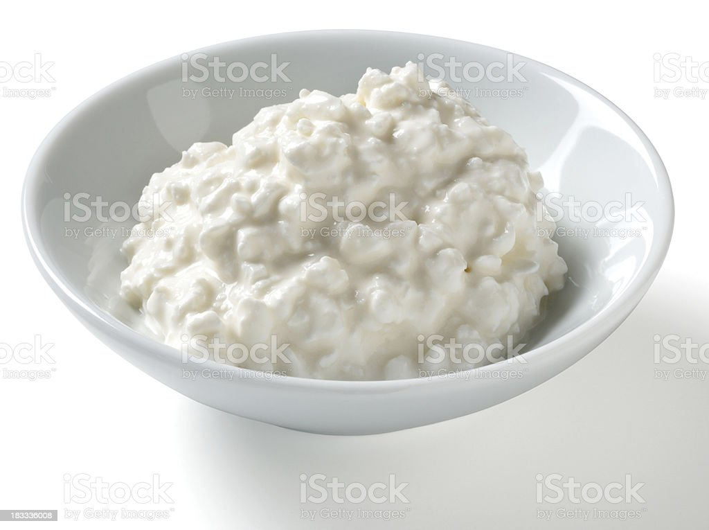 Half Cup serving of Cottage Cheese, white background stock photo
