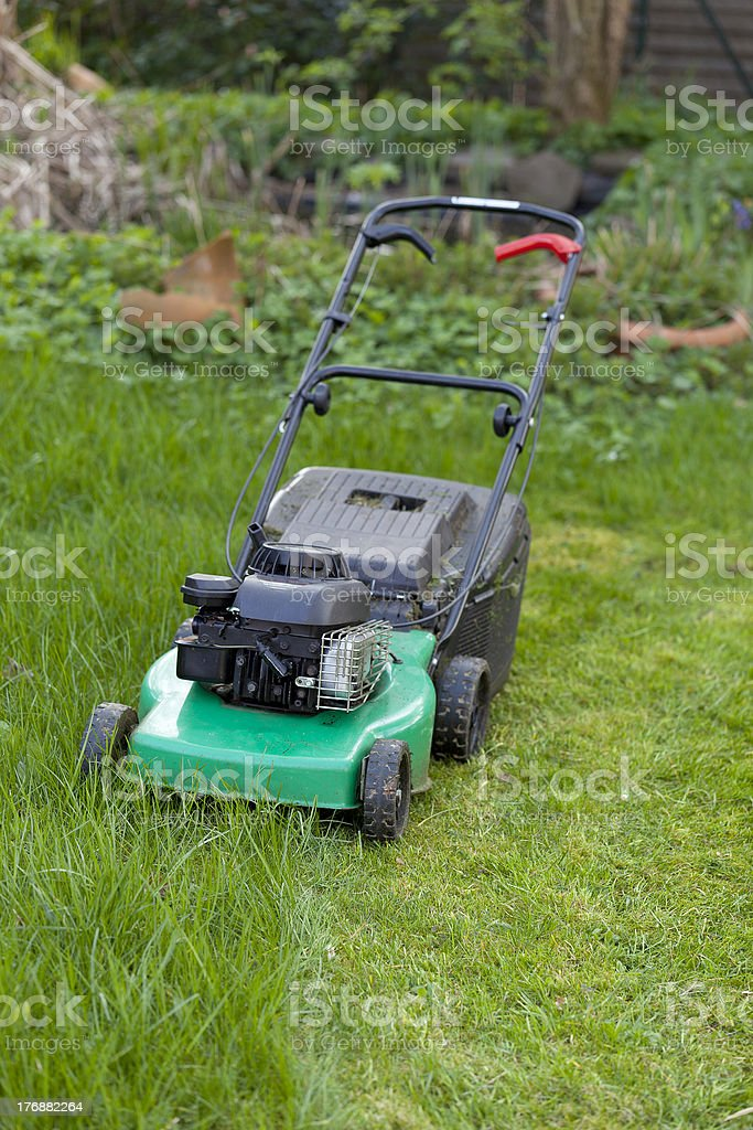 half cutted green lawn. royalty-free stock photo