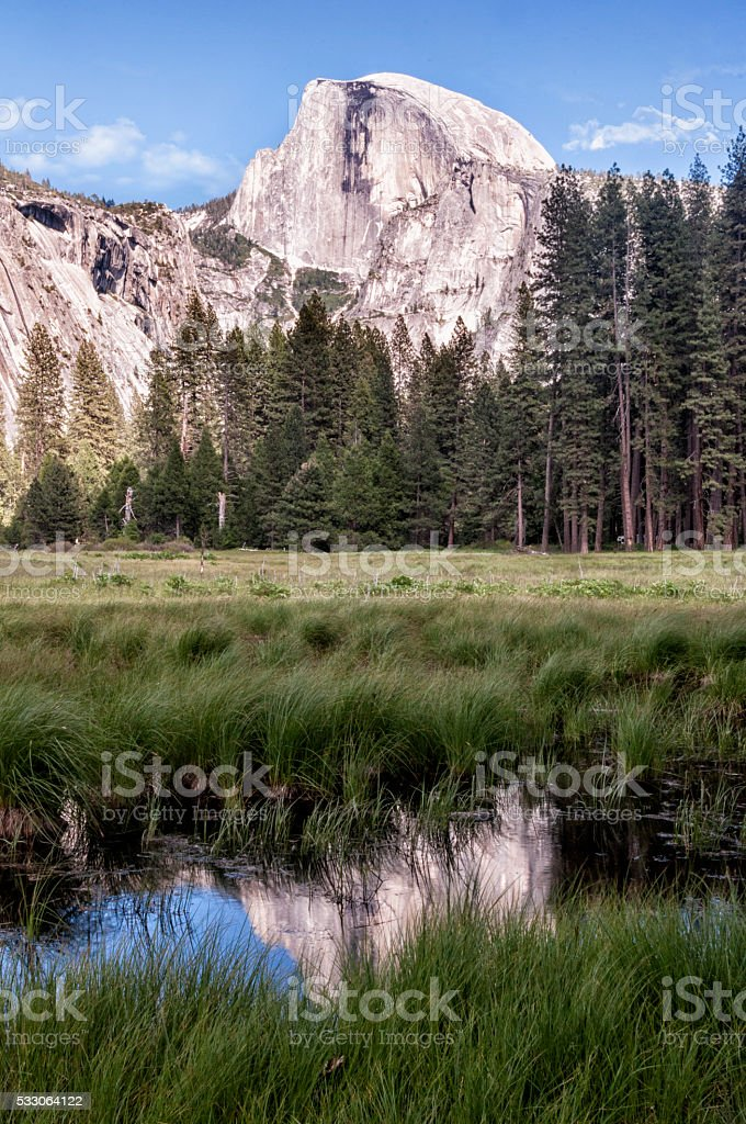 Half Dome in Yosemite National park on a sunny day stock photo