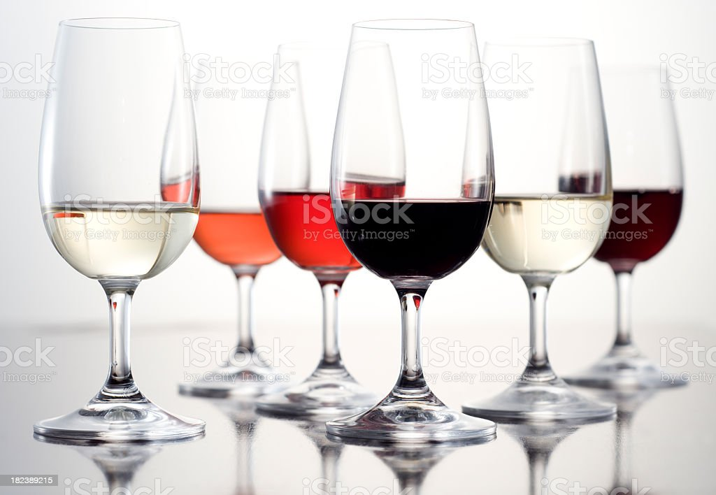 Half dozen of wine tasting glasses filled with wine royalty-free stock photo