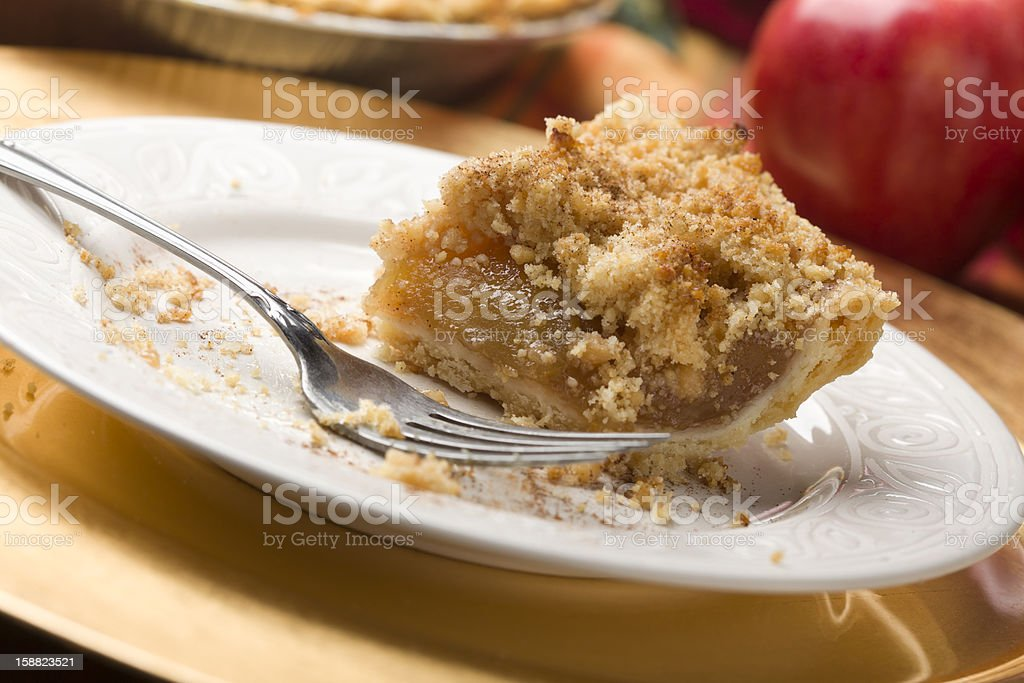 Half Eaten Apple Pie Slice with Crumb Topping stock photo