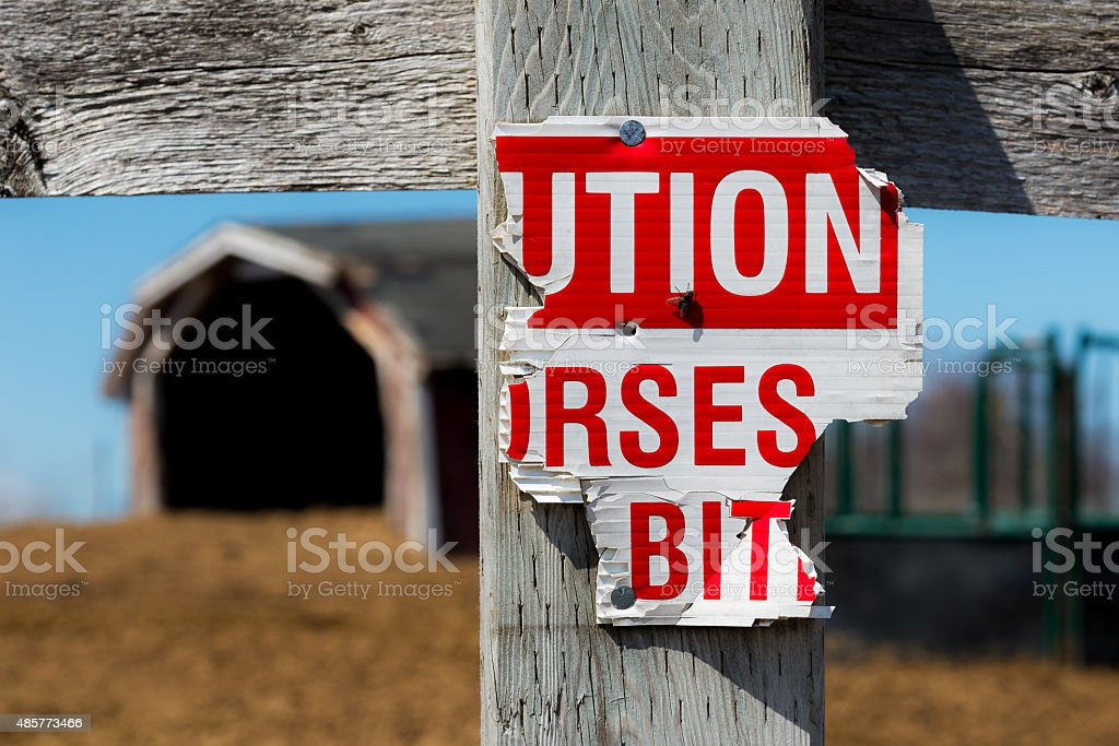 Half Eaten Horses May Bite Sign stock photo
