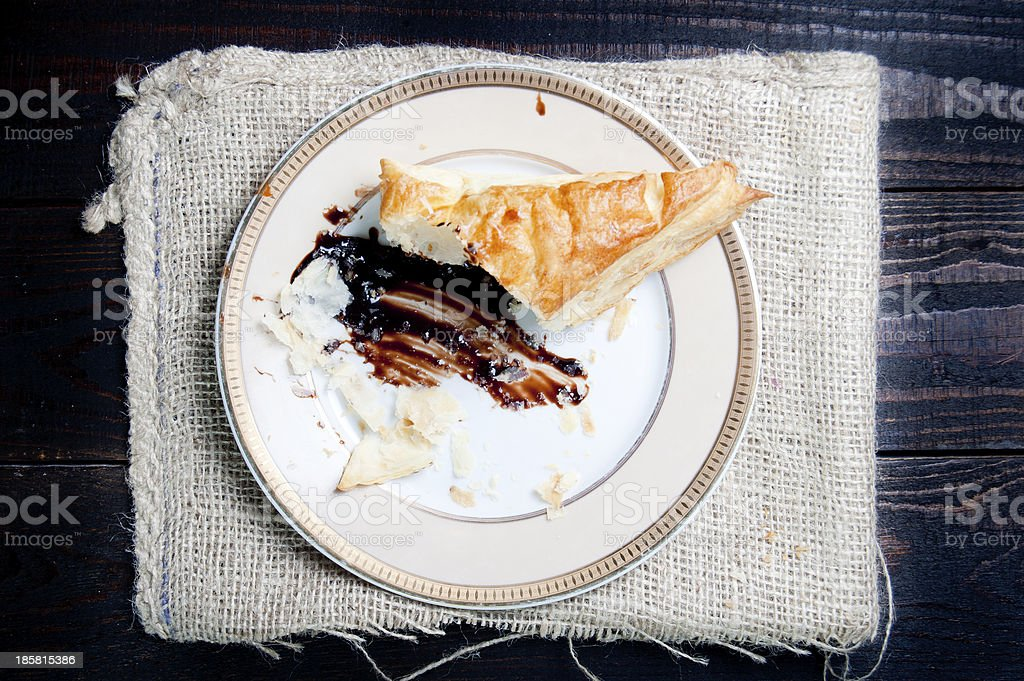 Half eaten puff pastry with chocolate royalty-free stock photo