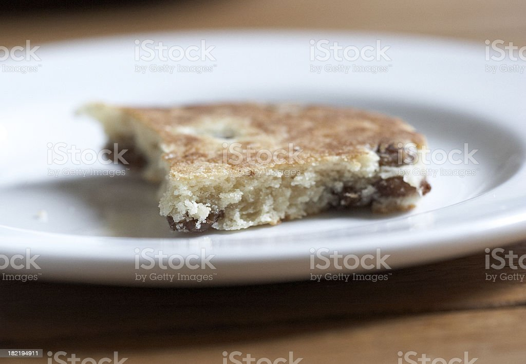Half eaten welshcake on a plate royalty-free stock photo