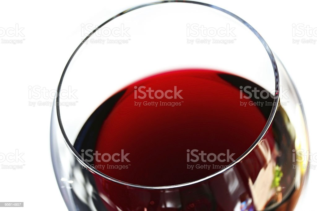 A half empty glass of red wine on a white background royalty-free stock photo