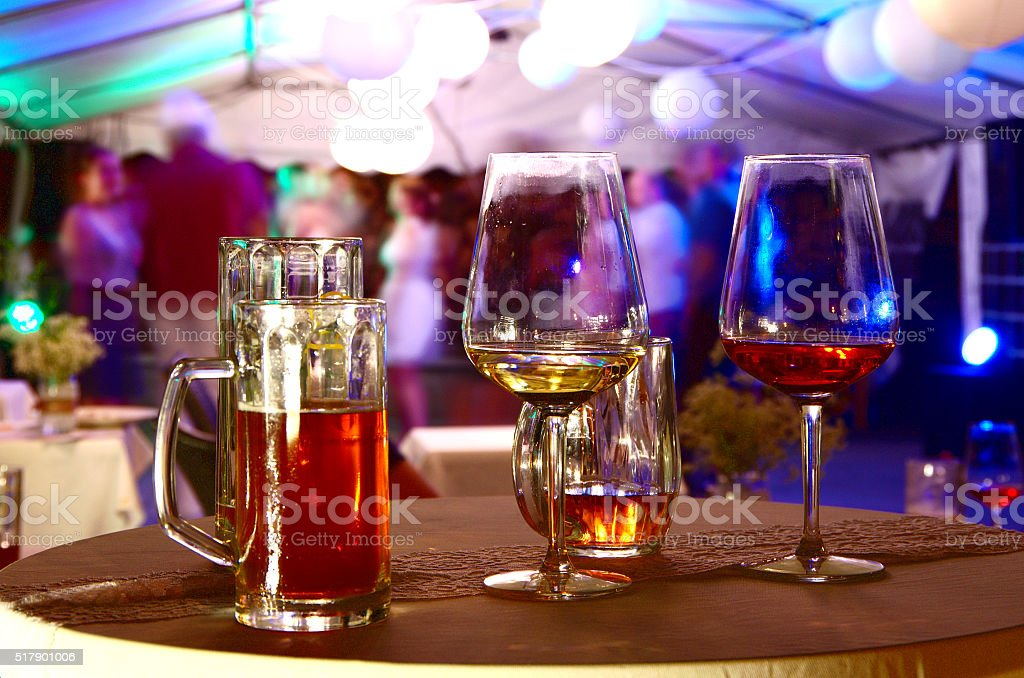 Half empty glasses on the party stock photo