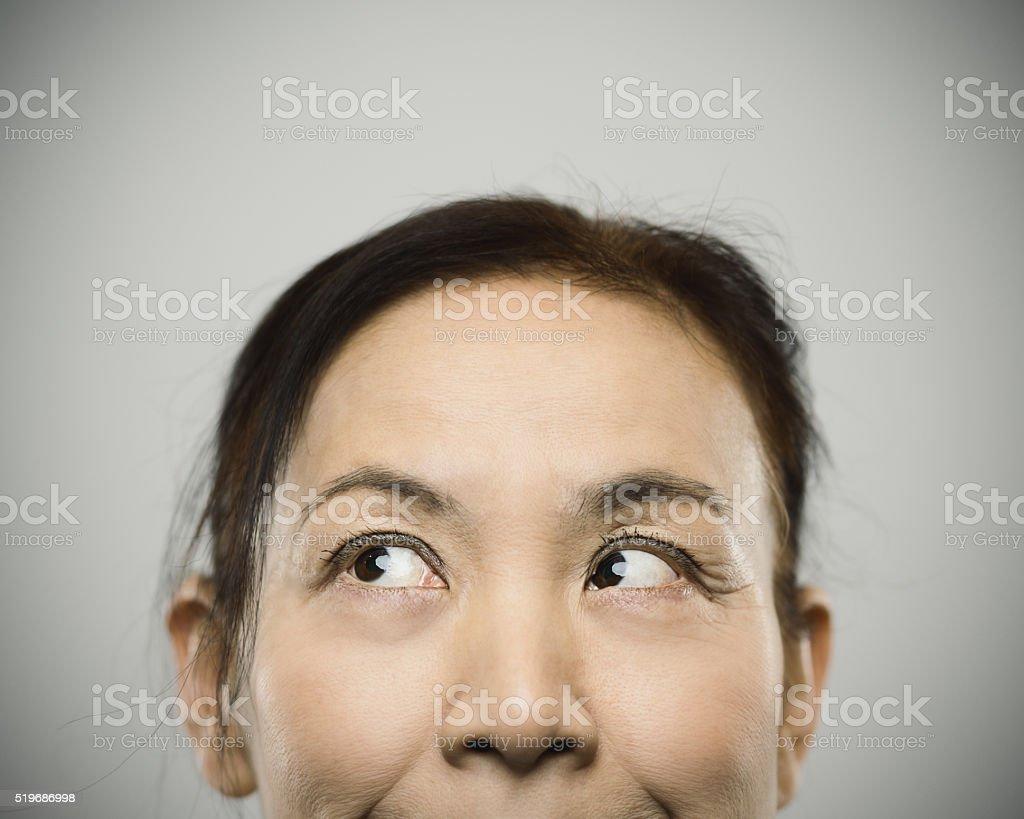 Half face portrait of a happy senior japanese woman. stock photo