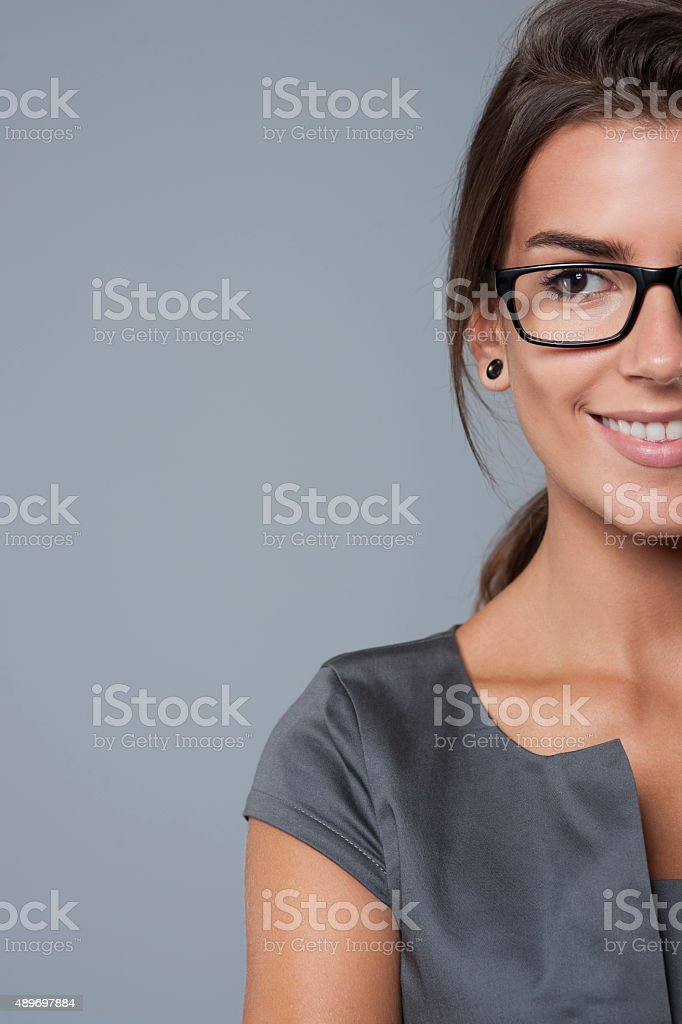 Half faced businesswoman looking at something stock photo