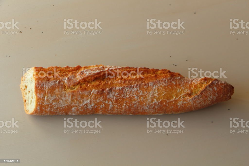 Half French baguette of bread stock photo