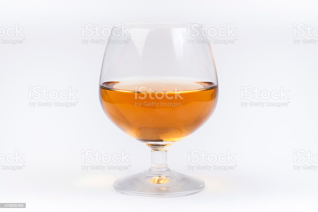 Half full glass of mead sitting on a white background stock photo