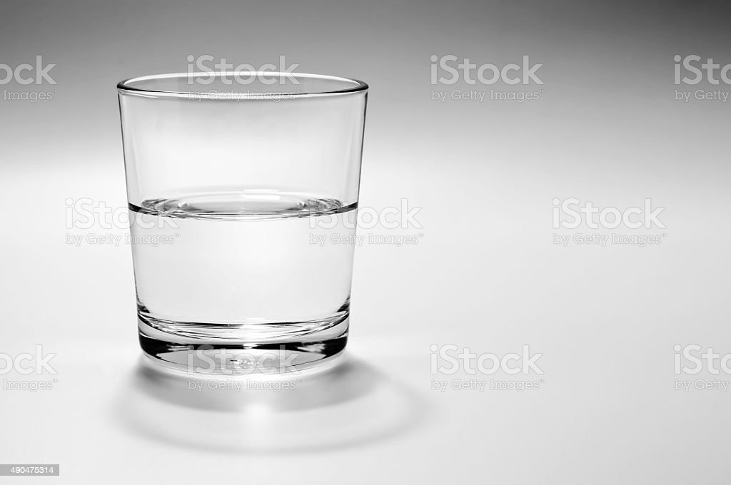 Half full, half empty glass of water stock photo