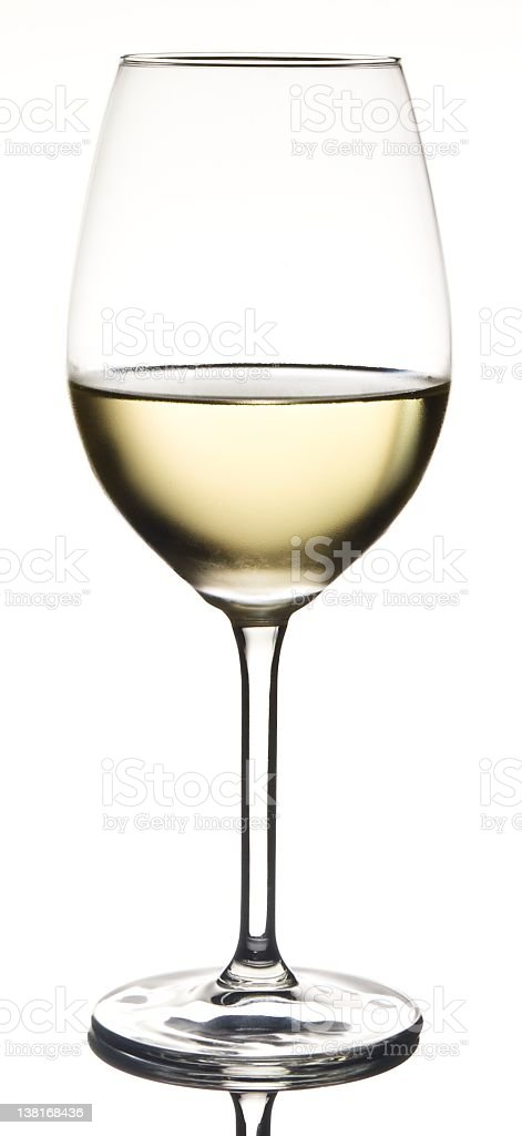 Half full white wine in glass with condensation stock photo