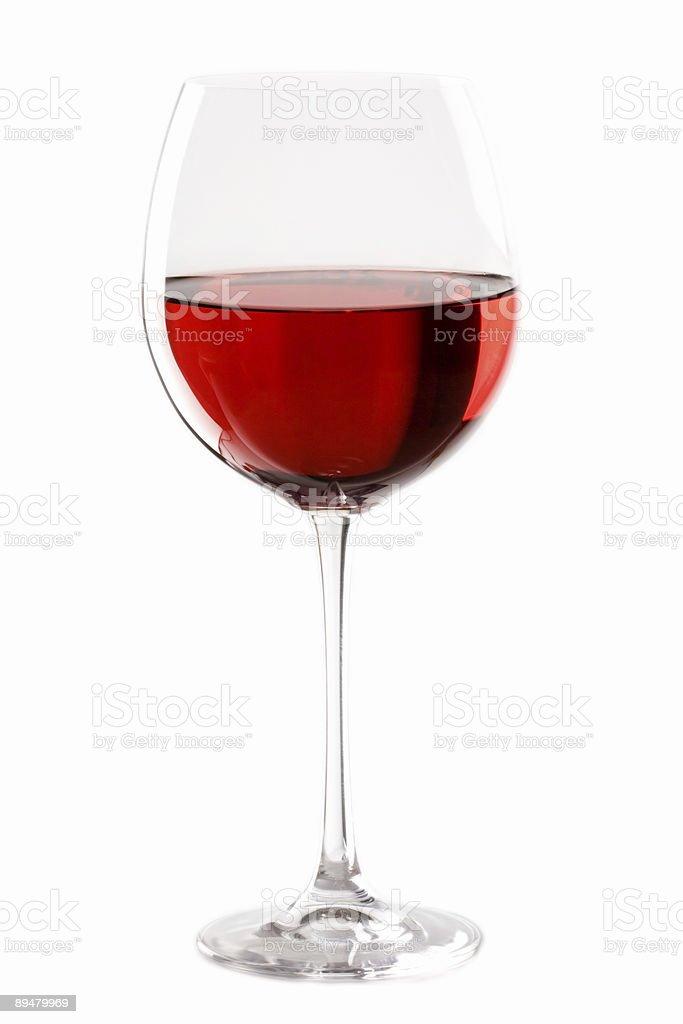 Half full wine glass of red wine stock photo