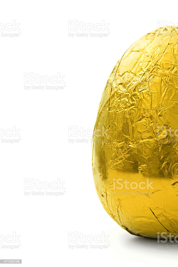 Half golden Easter egg on right royalty-free stock photo
