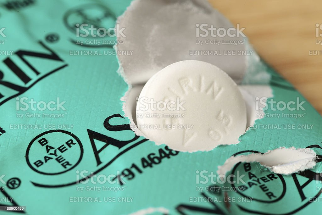 Half gram Bayer Aspirin tablet on blister pack stock photo