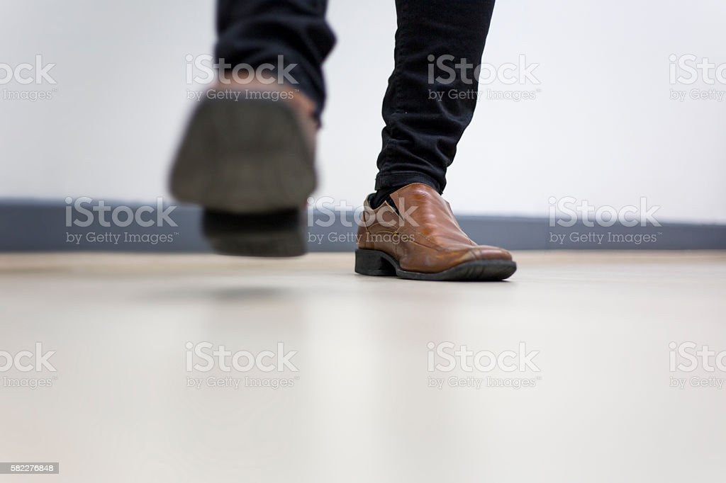 Half leg of man Walking in the office stock photo