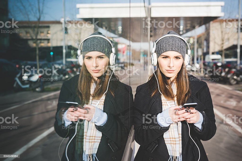 Half length of young beautiful caucasian woman listening music w stock photo