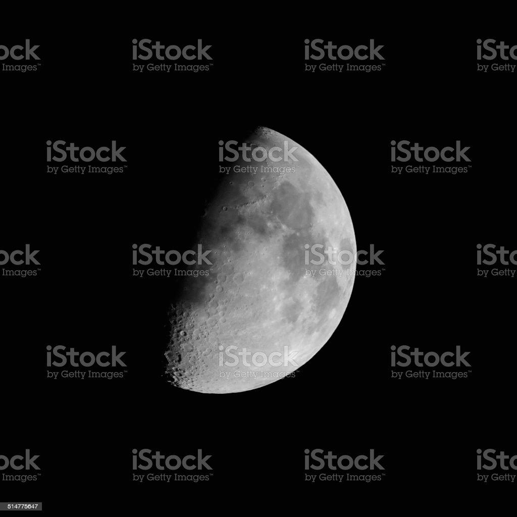 Half moon in night sky stock photo
