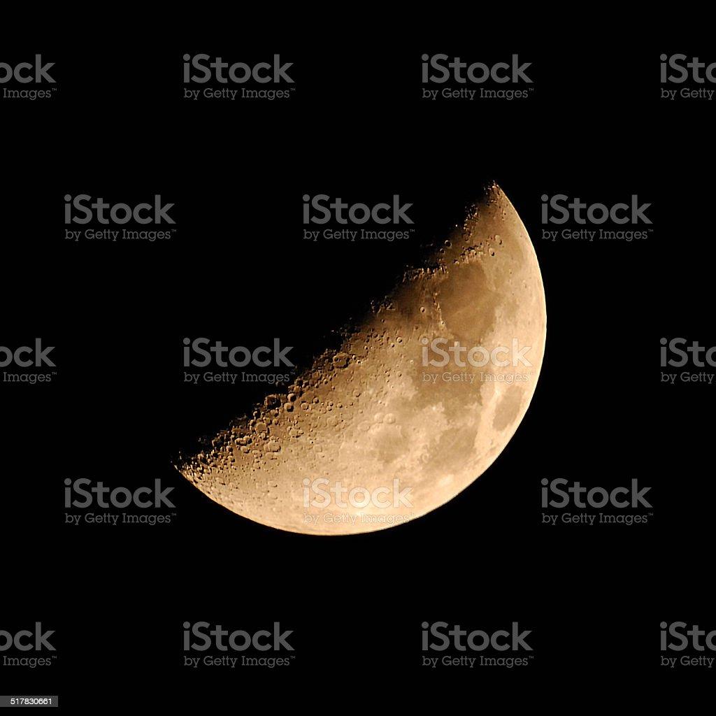Half moon in the night sky stock photo